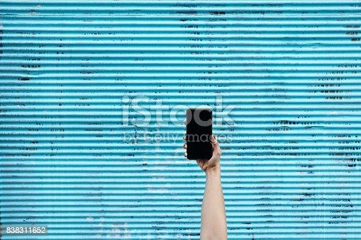 istock Hand holding Smartphone 838311652