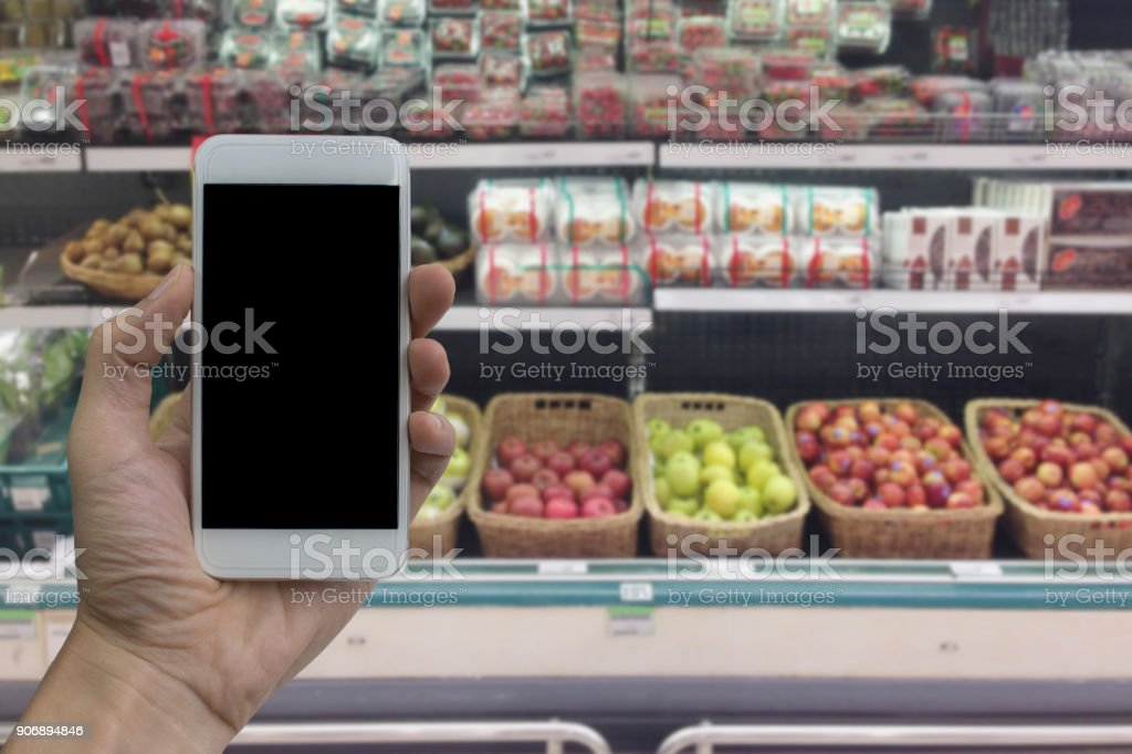 Hand holding smartphone stock photo