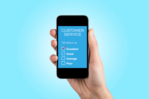Hand Holding Smartphone with Customer Service Survey on a Screen