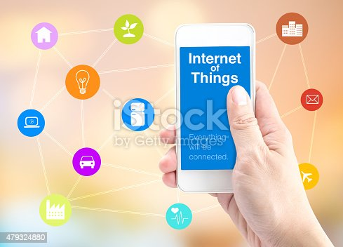1155191162 istock photo Hand holding smartphone with Internet of things (IoT) word 479324880