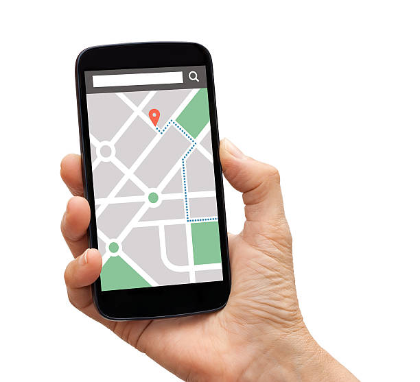 Hand holding smartphone with map gps navigation application on screen stock photo