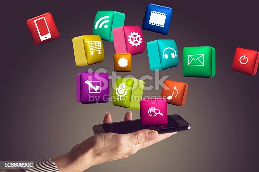 istock Hand holding smartphone with media icons and symbol 528606902