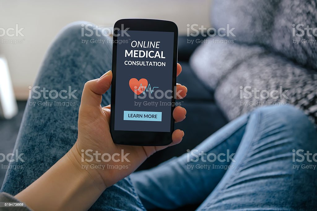 Hand holding smartphone with online medical consultation concept on screen stock photo