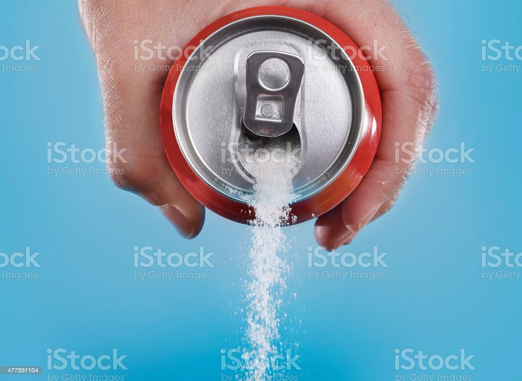 hand holding soda can pouring in metaphor of sugar content stock photo