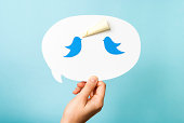 Hand holding speech bubble. Blue birds megaphone. Content marketing concept