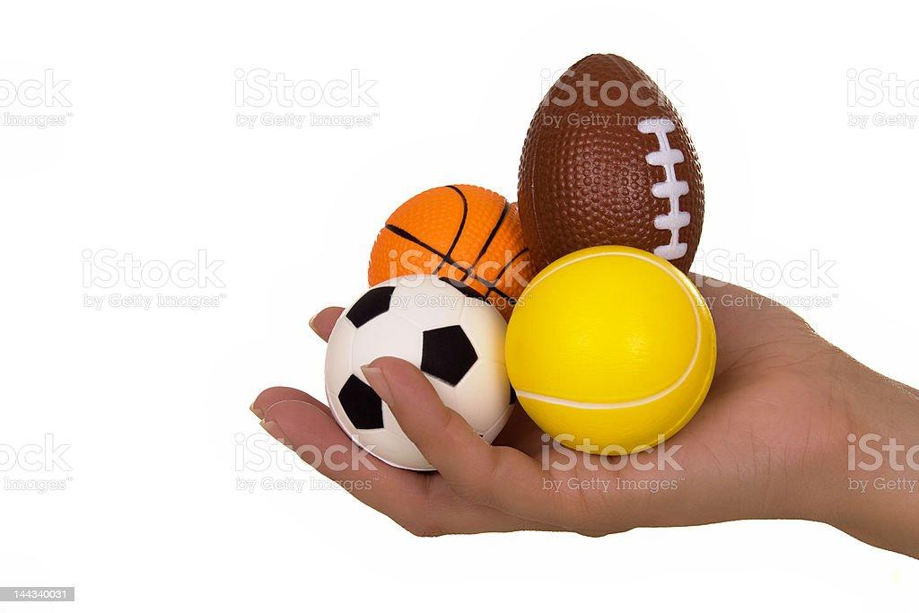 Mão a segurar Bolas de desporto - fotografia de stock