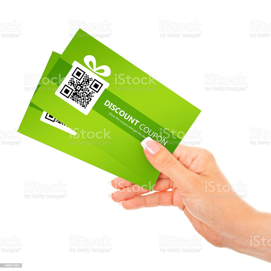 hand holding spring discount coupons isolated over white stock photo