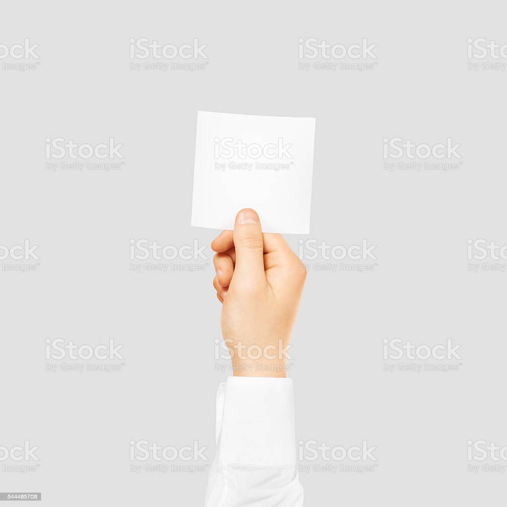 Hand holding square blank white sticker mock up isolated on stock photo