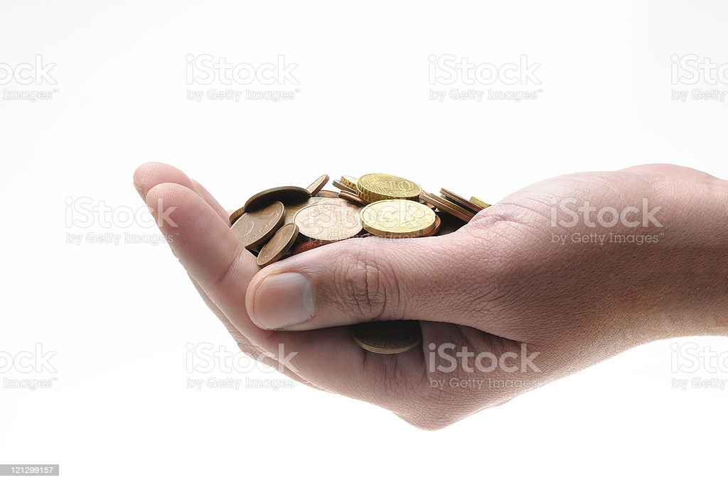 Hand holding stack of coins stock photo
