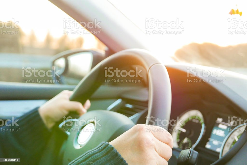 hand holding steering wheel stock photo
