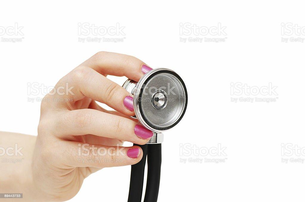 Hand holding stethoscope isolated on the white royalty-free stock photo