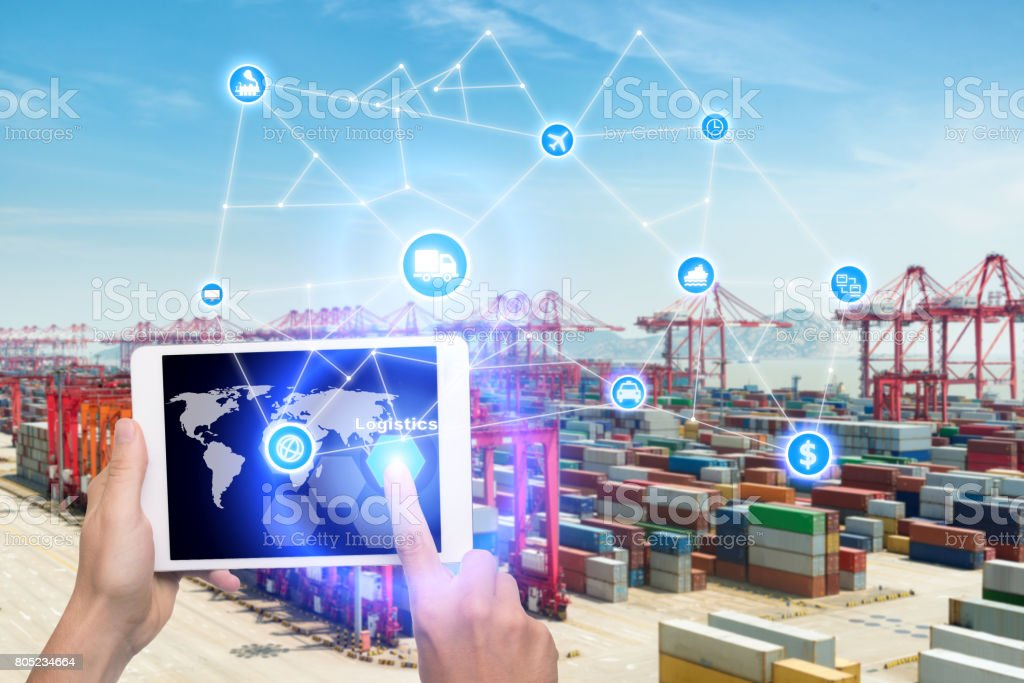 Hand holding tablet is pressing button Logistics connection technology interface global partner connection for logistic import export background. Business logistics concept , internet of things stock photo