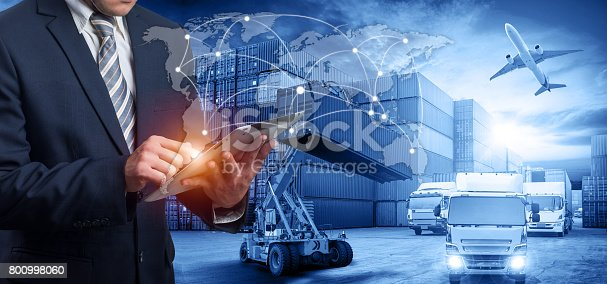 istock Hand holding tablet is pressing button on touch screen interface in front Logistics Industrial Container Cargo freight ship 800998060