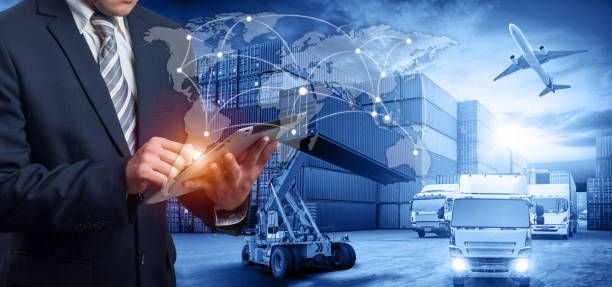 Hand holding tablet is pressing button on touch screen interface in front Logistics Industrial Container Cargo freight ship - foto stock