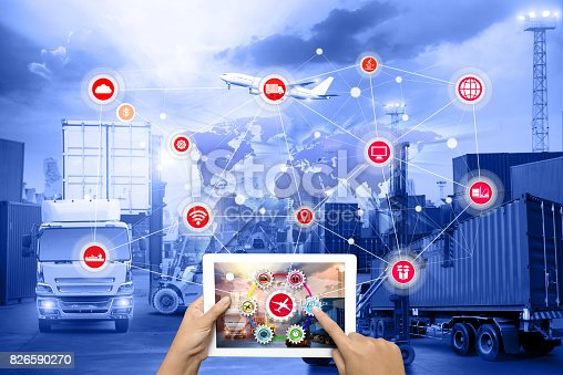 istock Hand holding tablet is pressing button on touch screen interface in front Logistics Industrial Container Cargo freight ship 826590270