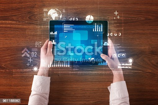 613550610istockphoto hand holding tablet 961188582
