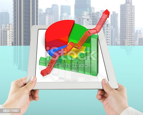 486439381istockphoto hand holding tablet with 3D chart 483075887