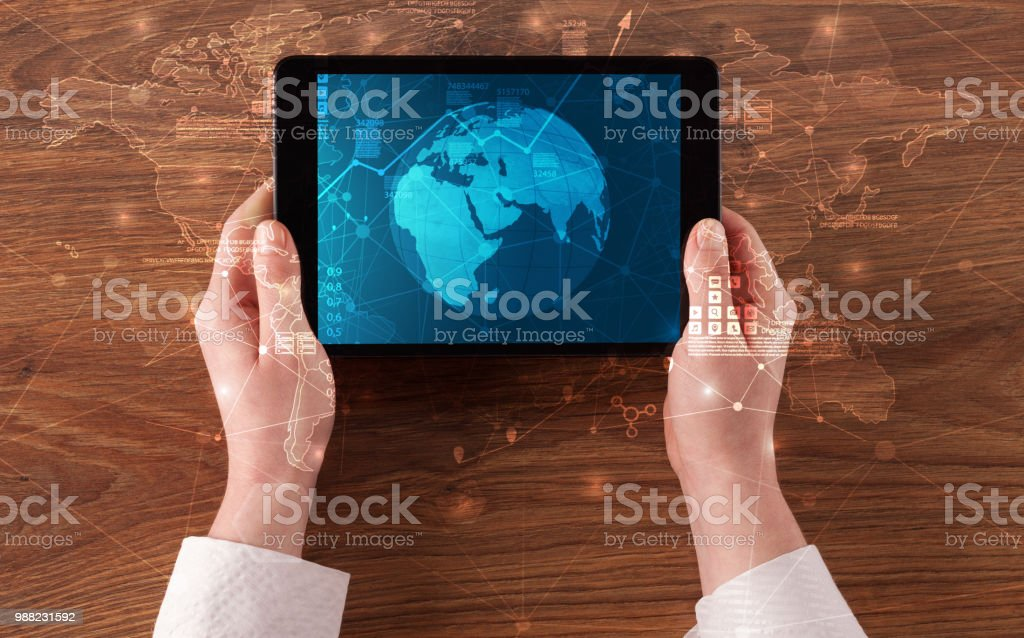 Hand touching tablet with worldwide reports links and statistics...