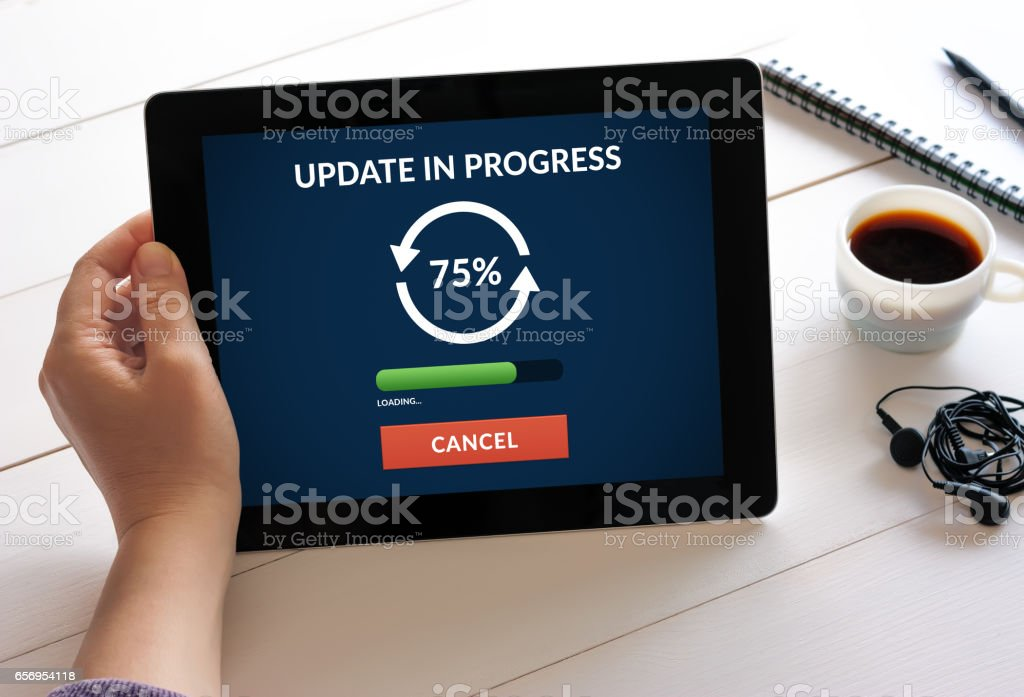 Hand holding tablet with update concept on screen stock photo