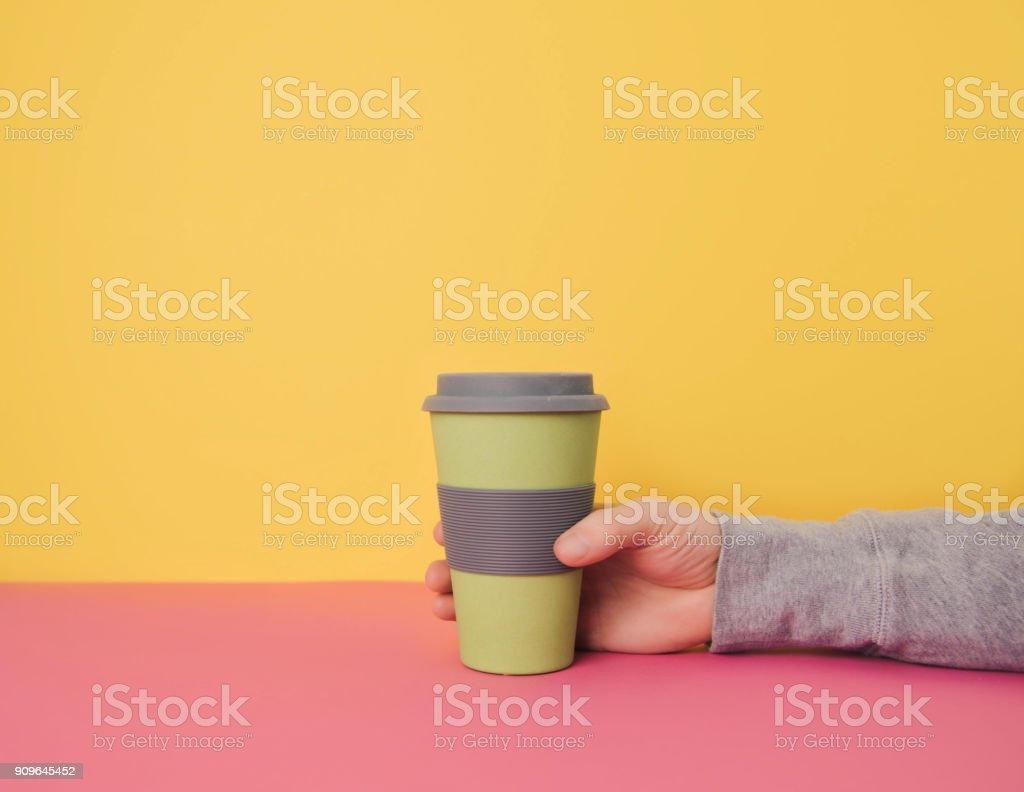 Hand holding take away coffee cup. stock photo