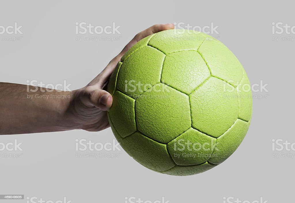hand holding team handball (with clipping path) stock photo