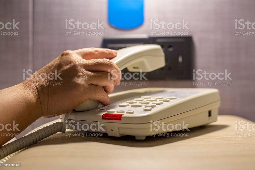 hand holding telephone handset stock photo