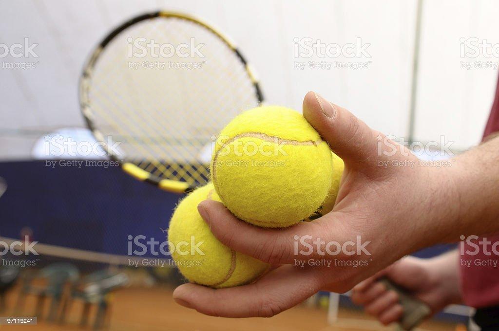 Hand holding tennis balls. royalty-free stock photo