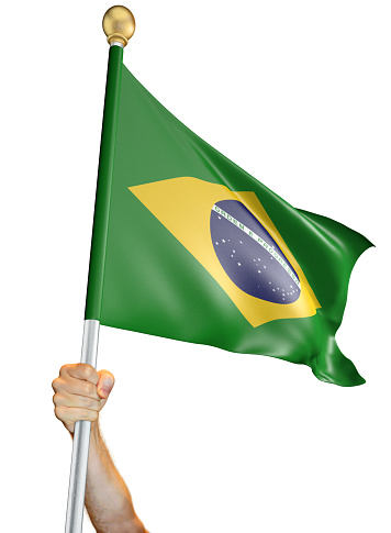 Man's hand holding a flag pole with the Brazilian national flag proudly displayed against a white background. The flag has been rendered with 3D software.