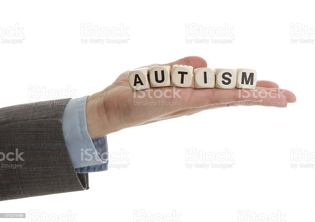 Hand Holding the Word Autism stock photo