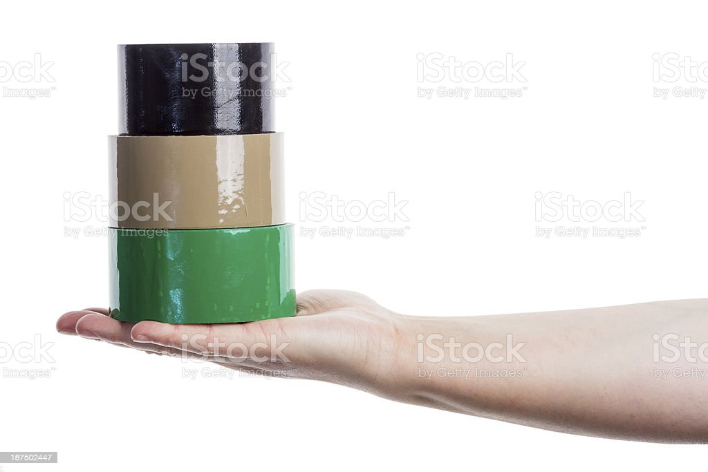 Hand holding tower made of adhesive tape royalty-free stock photo