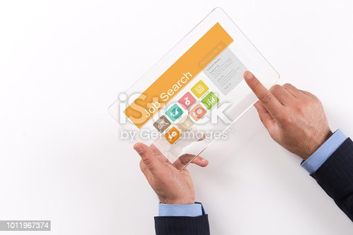 477419728istockphoto Hand Holding Transparent Tablet PC with Job Search screen 1011967374