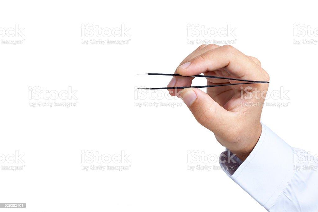 Hand holding tweezers stock photo