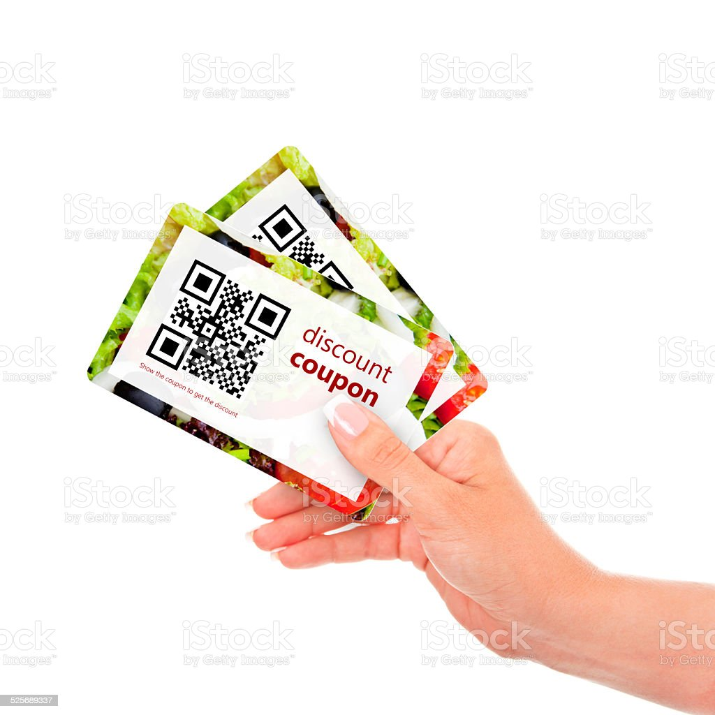 hand holding two  discount coupons with qr code stock photo