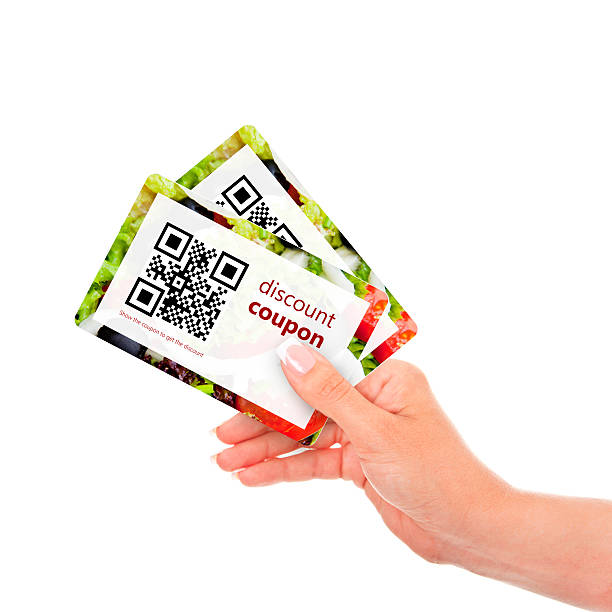hand holding two  discount coupons with qr code hand holding two  discount coupons with qr code isolated over white background salé morocco stock pictures, royalty-free photos & images