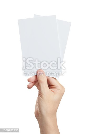 Hand holding two small sheets of paper (tickets, flyers, invitations, coupons, banknotes, etc.), isolated on white background