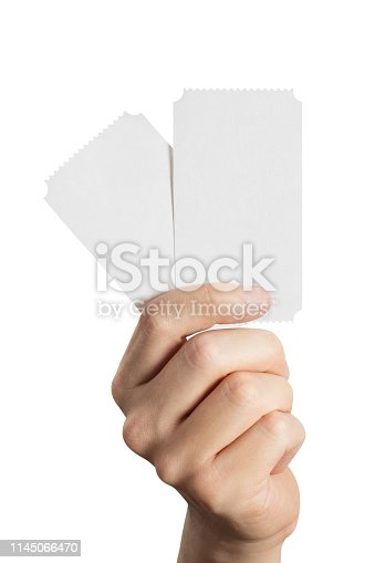 Hand holding two tickets, flyers, invitations, coupons, etc., isolated on white background