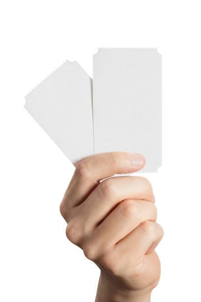 hand holding twee tickets, flyers, uitnodigingen, coupons, enz. - ticket stockfoto's en -beelden