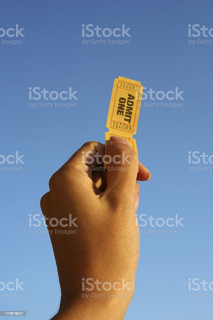 Hand Holding Two Tickets stock photo