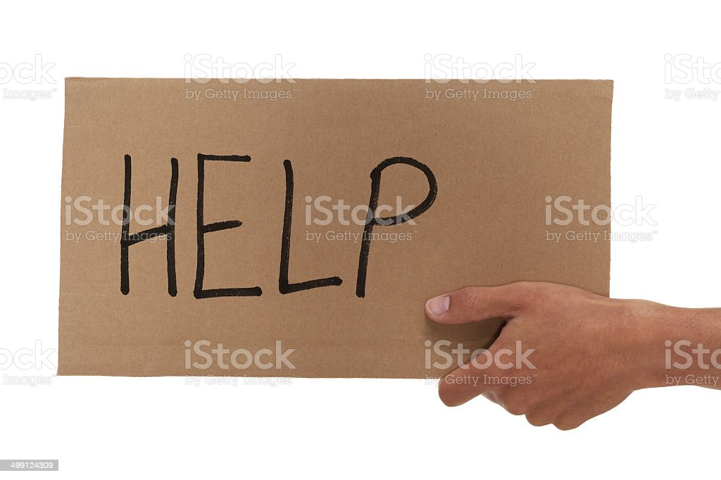 Hand holding up a cardboard help sign stock photo