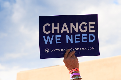 Espanola (NM), USA- September 18, 2008: A hand holding up an Obama slogan (Change We Need) at an Obama-for-President political rally in 2008 in Espanola, NM, 25 miles north of Santa Fe.