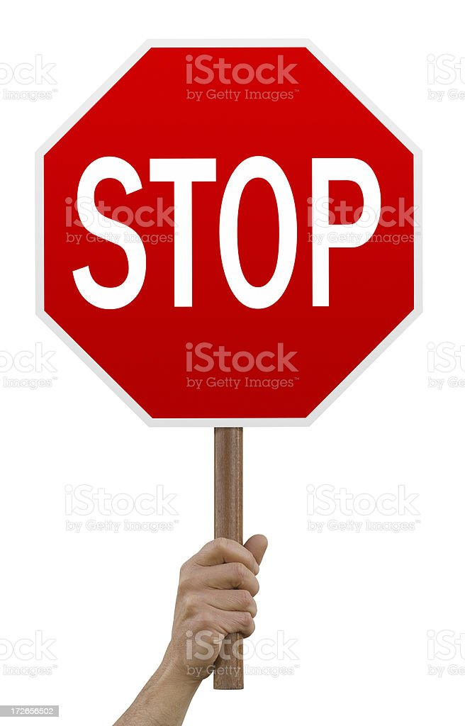 Hand holding up red octagonal stop sign stock photo