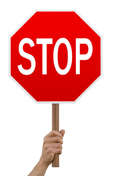 Hand holding up red octagonal stop sign stop sign,isolated on white, stop single word stock pictures, royalty-free photos & images
