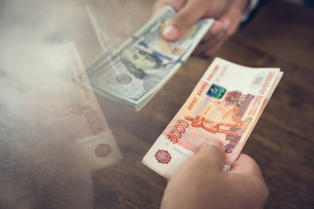 Hand holding US dollar bills trading with Idian Rupee Money Hand holding US dollar bills trading with Indian Rupee - foreign money conversion and exchanging concept currency exchange stock pictures, royalty-free photos & images