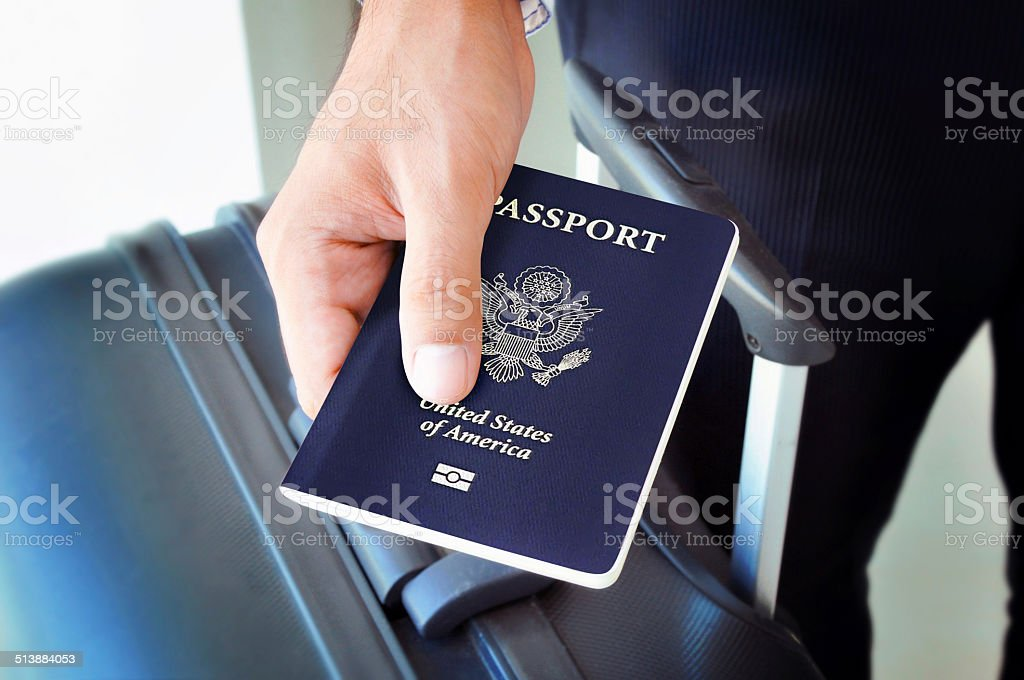 Hand holding U.S. passport stock photo