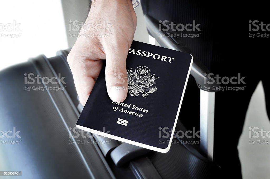 Hand holding U.S. passport stock photo
