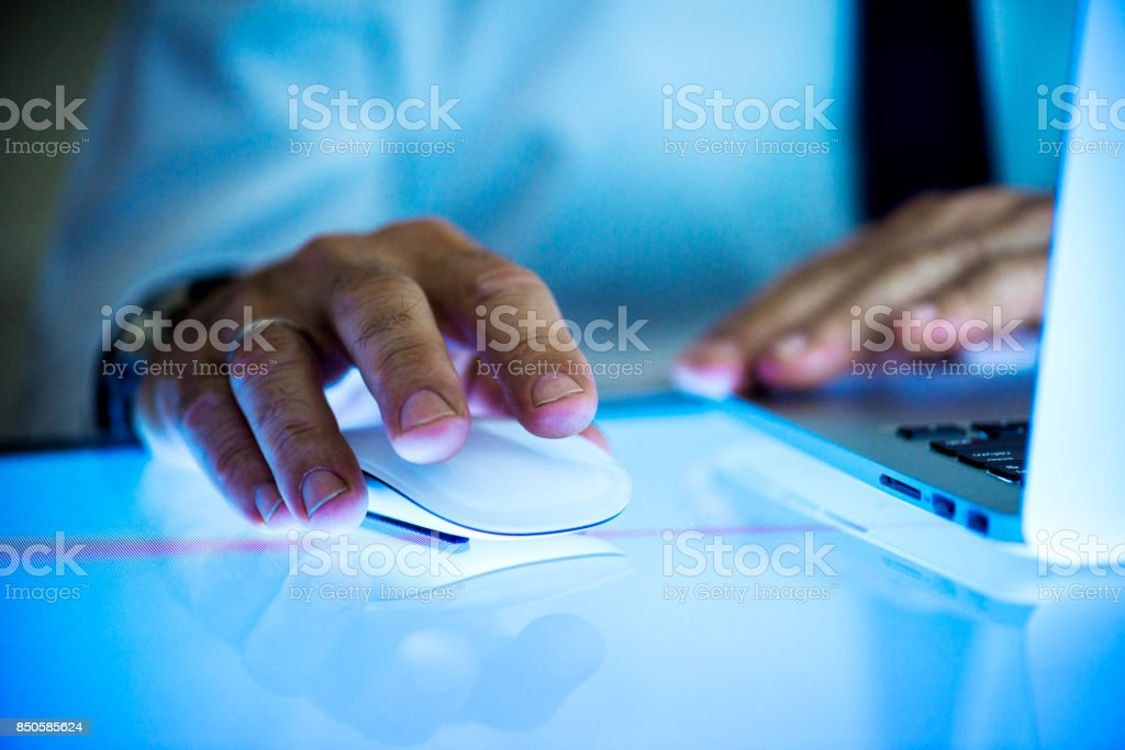 Hand holding using mouse clicking stock photo