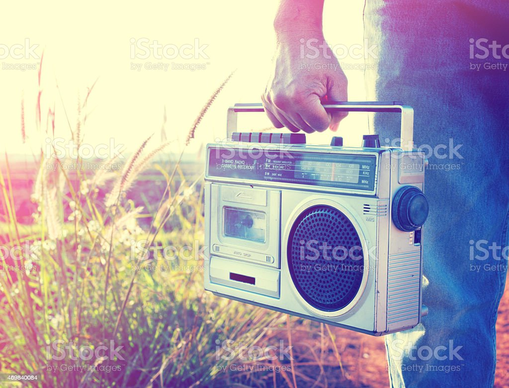 hand holding vintage radio stock photo