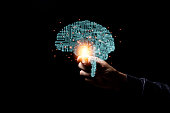 istock Hand holding virtual illustration infographic brain with glowing light  . Brain is centralise to control creativity  idea memory and psychology. 1221156138