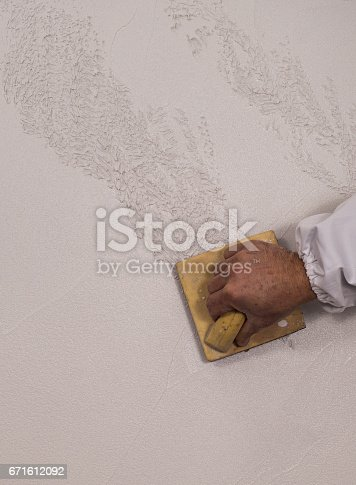 istock Hand holding wall tool,spring home decoration 671612092