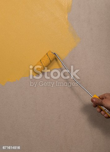 istock Hand holding wall tool,spring home decoration 671614516